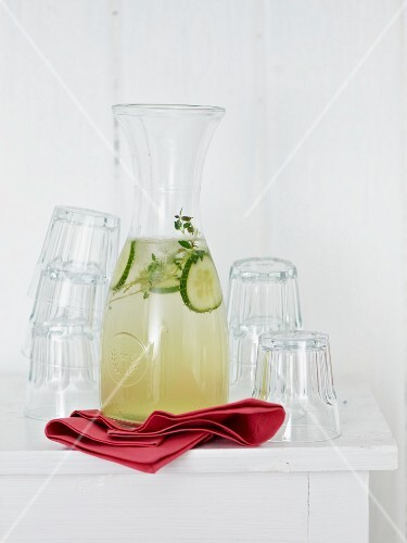 Homemade herb and cucumber lemonade in a carafe
