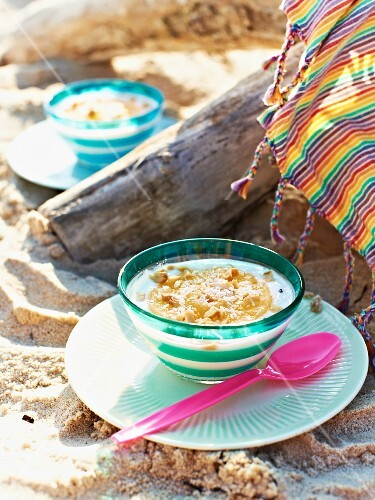 Yoghurt with pineapple and peanuts for a Caribbean picnic on a beach