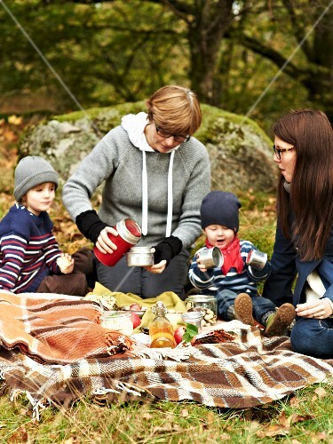 A family having an autumnal picnic in a forest