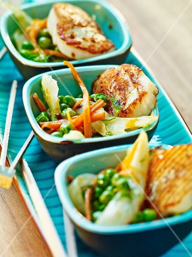 Grilled scallops on vegetables