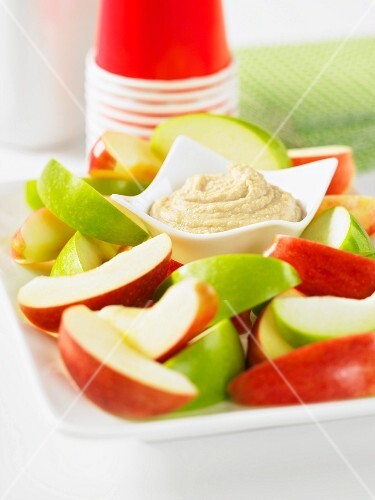 A cashew nut dip with apple wedges