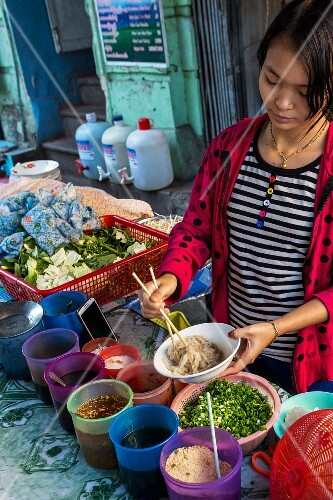 Noodles being prepared at a market in Myanmar