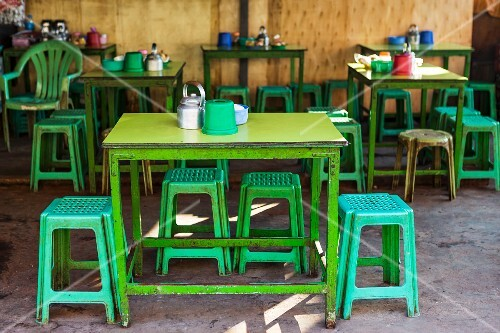 Tables in a noodle bar at a market in Myanmar