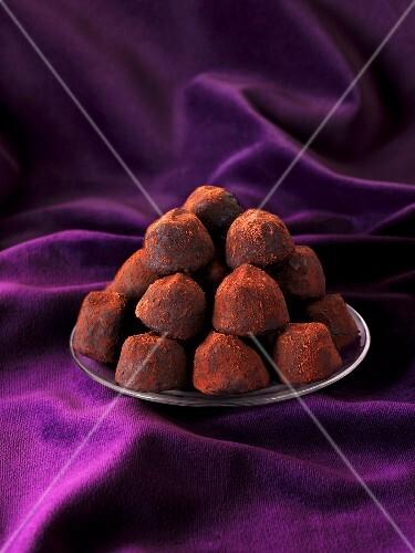 Dark chocolate truffles on a plate