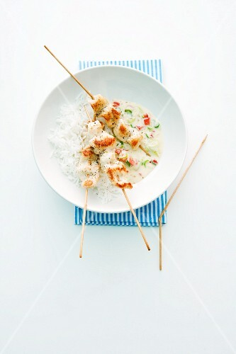 Chicken skewers with rice and wasabi sauce