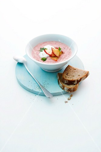 Beetroot soup with apple horseradish and slices of apple