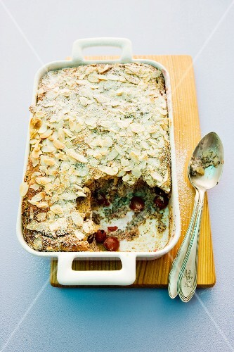 Mohnmichel (poppy seed bread pudding) with cherries and slivered almonds