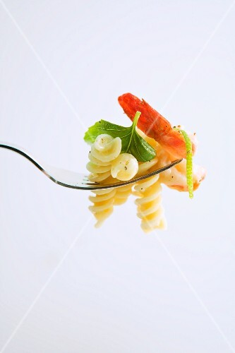 Fusilli with prosecco sauce and a prawn on a fork