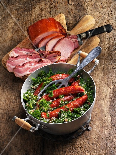 Green kale with smoked pork chops, Pinkelwurst (smoked sausage from bacon, groats and spices) and bacon