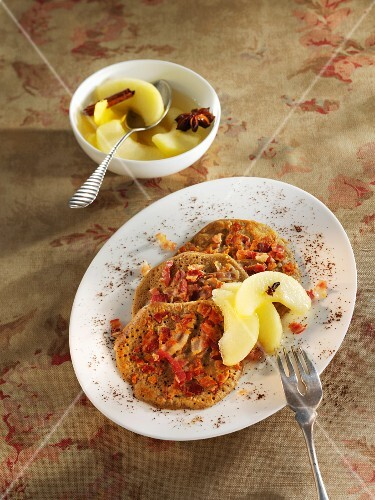 Buckwheat pancakes with bacon served with apple compote