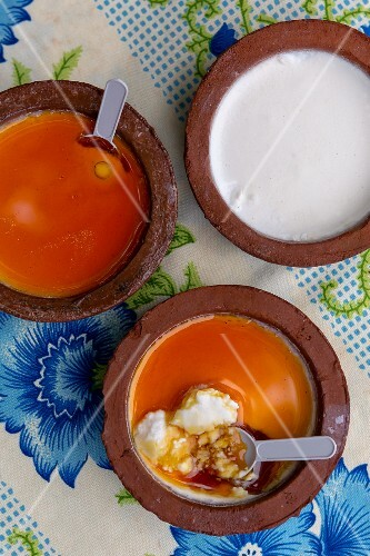 Quark with honey in three terracotta bowls (Sri Lanka)