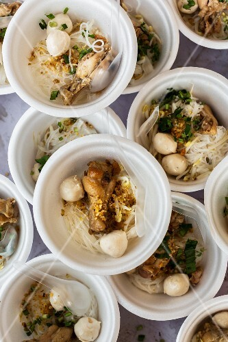 Bowl of rice noodles with chicken at a market (Thailand)