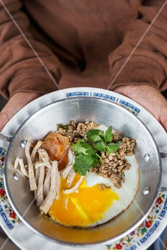 A Thai breakfast consisting of pork and egg