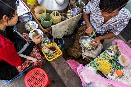 A noodle restaurant at a market in Myanmar