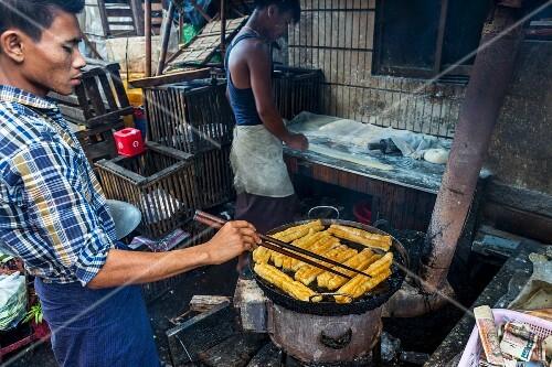 Deep fried pastries in a street kitchen in Myanmar