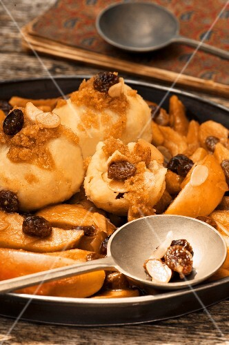 Potato dumplings with baked apple compote