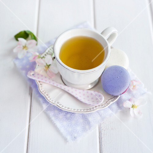 A cup of tea with a macaroon