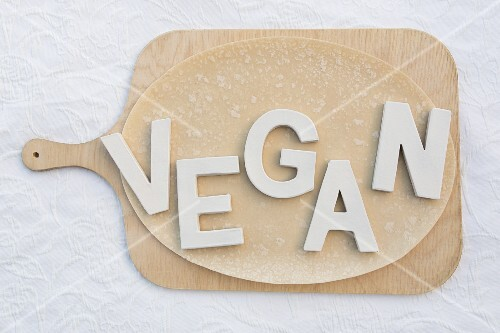 The word 'Vegan' spelt out on pizza dough