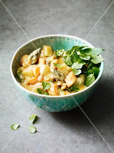 Coconut and peanut curry with asparagus