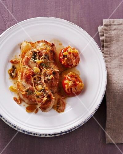 Iberian pork steak with stuffed tomatoes