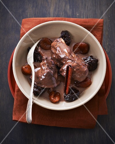 Rabbit with dried fruits and cinnamon in a red wine sauce