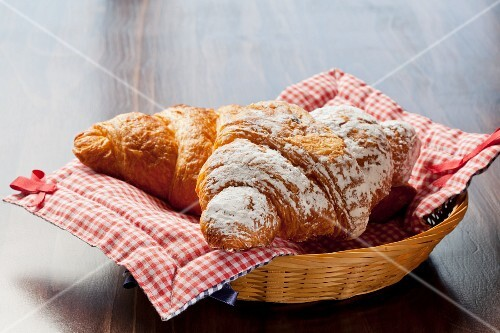 Chocolate and cinnamon croissants in a bread basket