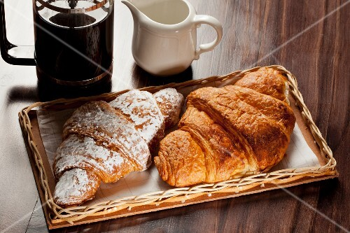Chocolate and cinnamon croissants and black coffee