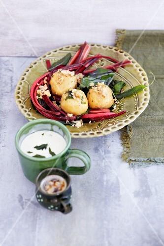 Walnut dumplings with chard