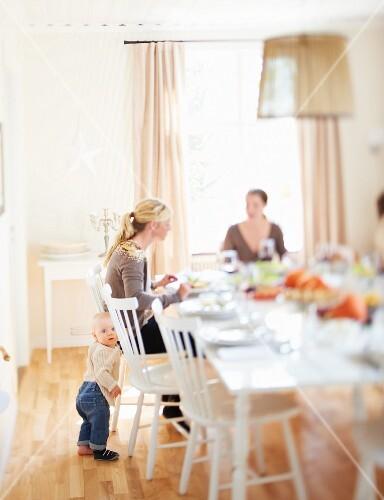 A family eating Thanksgiving dinner