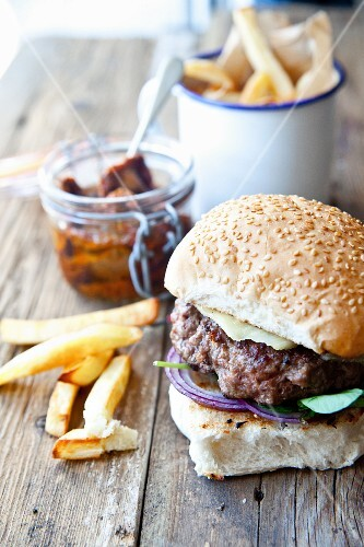A homemade cheeseburger with watercress and chips