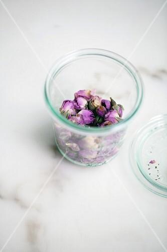 Dried rose buds in preserving jar