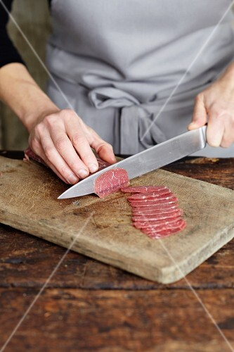 Beef fillet being sliced for carpaccio