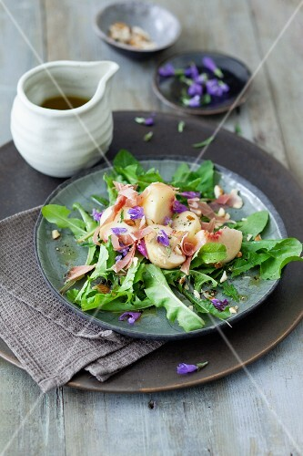 A dandelion leaf salad with peaches and ham