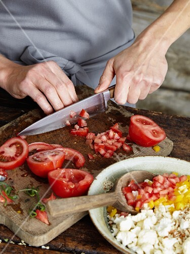 Tomatoes being diced