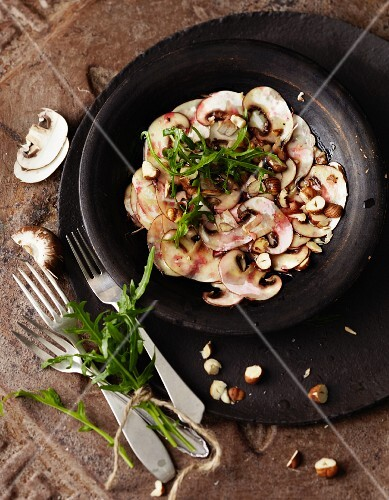 Mushroom carpaccio with hazelnuts