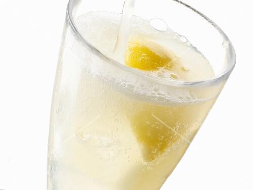 A glass of fizzing lemonade