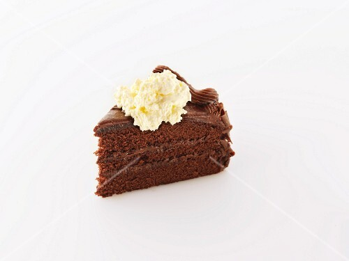 A Slice of Rich Chocolate Layer Cake with Whipped Cream