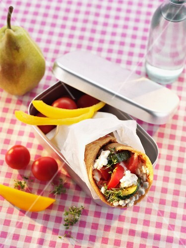 A vegetable wrap in a lunch box