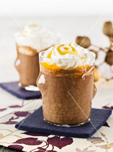Spiced hot chocolate with cream and orange syrup