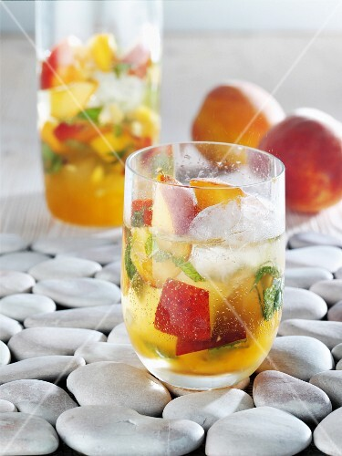 Peach punch with ice cubes