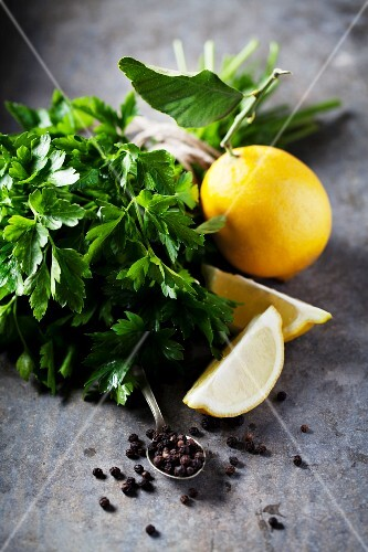 An arrangement of lemons, parsley and peppercorns