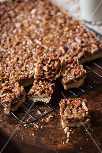 Pecan nut slices on a cooling rack