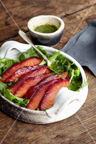 Homemade cured salmon with vodka, beetroot and dill sauce