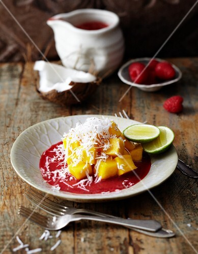 Diced mango with grated coconut and raspberry puree