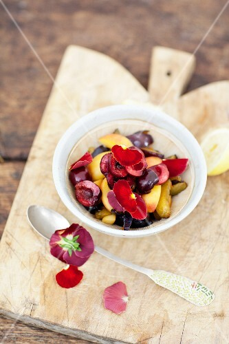 Sweet cherry salad with apricots and summer plums