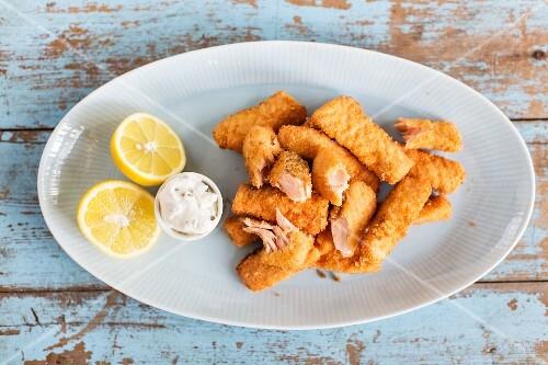 Salmon fish fingers with tartare sauce and lemon