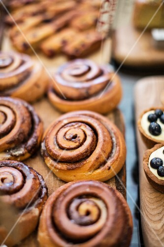 Cinnamon buns and blueberry tartlets