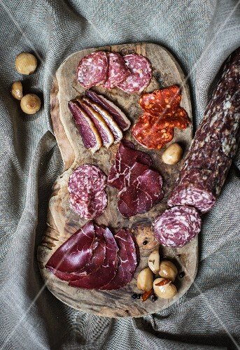 A charcuterie board featuring Grisons air-dried beef and salami