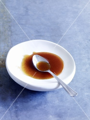 Caramel sauce on a plate with a spoon