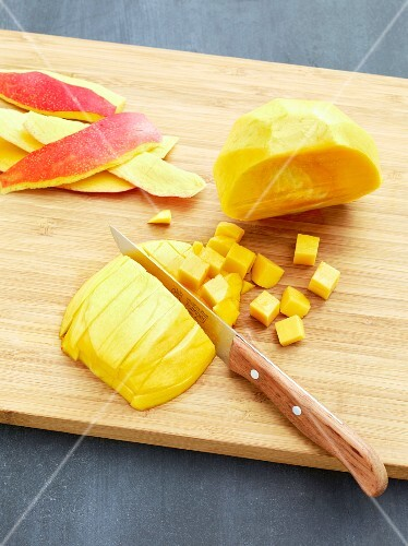 A mango being diced